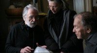 "Michael Haneke on the set of ""Amour"" with Emmanuelle Riva and Jean-Louis Trintignant"